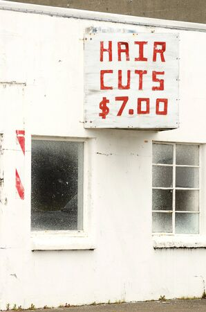An old now closed barber shop in the Empire district, Coos Bay Oregon at har cuts seven dollars Stock Photo - 21293882