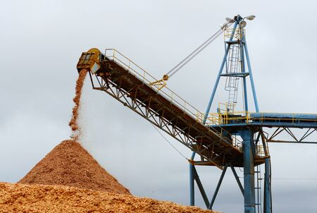 wood cut: Larch wood chip processing facility piling up chips to be loaded on a ship for export in Coos Bay Oregon Stock Photo