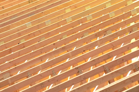 rafters: A roofing contractor installing rafters at a commercial residential development