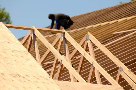 A roofing contractor installing rafters at a commercial residential development    photo