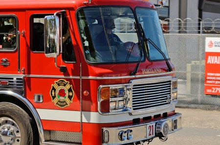 responds: Portland, OR - July 14, 2013: A fire engine responds to a medical emergency in the industrial areal of Portland Oregon on July 14th, 2013