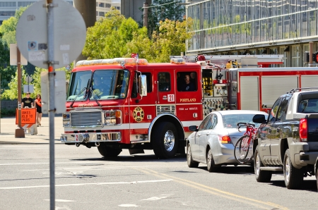 responds: Portland, OR - July 14, 2013  A fire engine responds to a medical emergency in the industrial areal of Portland Oregon on July 14th, 2013
