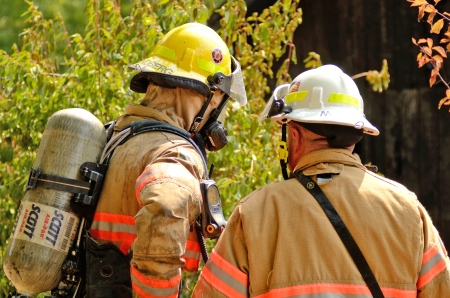 turnouts: Roseburg, Oregon - July 31, 2013: Fire fighters respond to a structure fire in a residence that caused major interior damage.  No body was injured in the Roseburg, Oregon incident on July 13, 2013