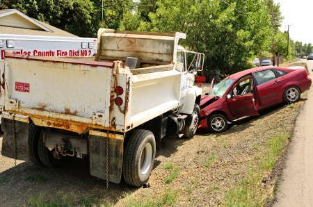 reasons: A small car ran off the road for unknown reasons and ran into a dump truck parked at a construciton site in Roseburg, OR on August 8th, 2013