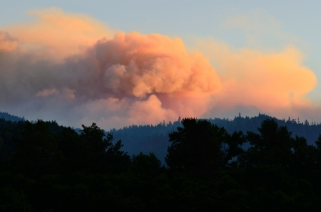 Smoke comes from the Dads Creek fire part of the Douglas Complex fires near Glendale Oregon on July 28, 2013
