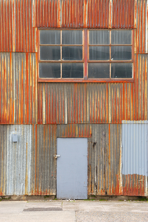 warehouse building: rusted corrigated metal wall of a warehouse building in a industrial district of Portland Oregon Stock Photo