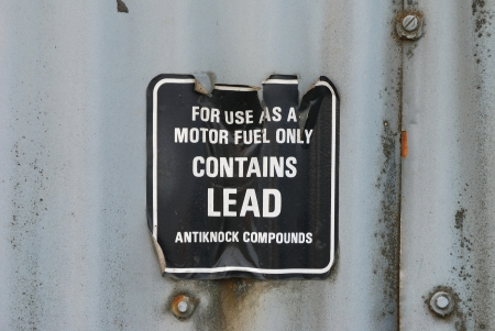 Old sign contains lead decal for motor fuel