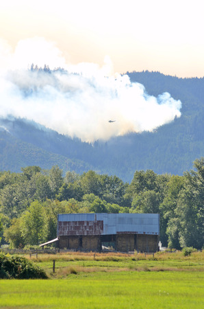 rugged terrain: Smoke rises from the Douglas Complex forest fires near Glendale Oregon in steep rugged terrain of the southern coastal range mountains