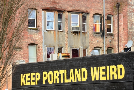 Keep Portland Weird sign in downtown Portland Oregon wall of a parking garage