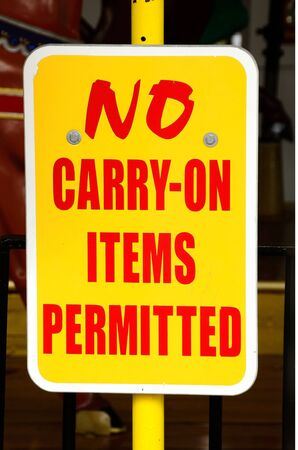 shorter: No Carry On items permitted sign at the Oaks Amumsment park in Portland Oregon Stock Photo