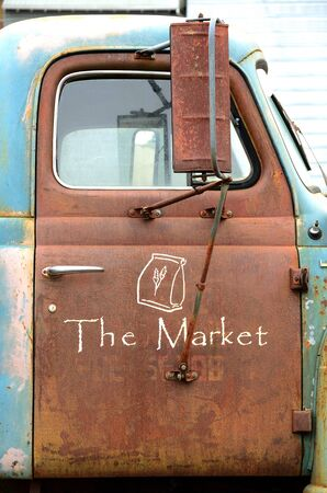 Sign on a truck outside a farmers market in McMinnville Oregon photo