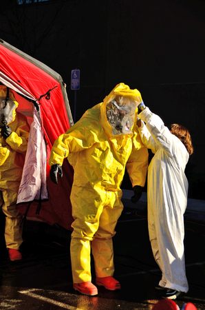 hazardous material team: Hazardous materials response to a hospital were contaminated victims showed at the ER entrance  drill  Editorial