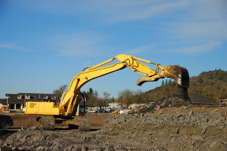 blasted: Excavation equipment moving the blasted rock during a large coonstruction project in Roseburg Oregon