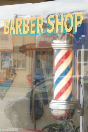 haircut: Barber shop sign and window front in downtown Wenantchee WA Stock Photo