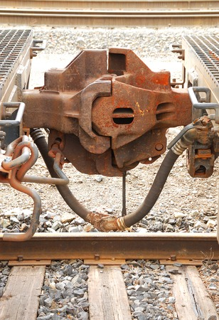 coupling: rail car couplers conected at a railyard Stock Photo