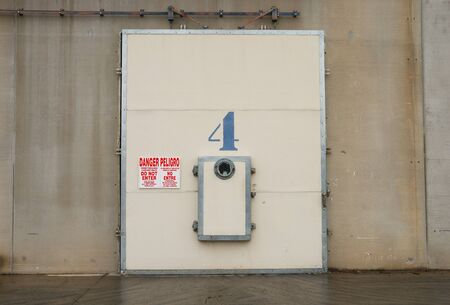 confined space: Doors to cold storage warehouse with warning signs, Wenatchee Washington.