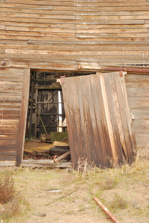 Old barn that is is in danger of falling over in the high desert of Washington state  photo