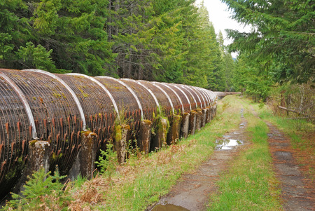 hydroelectricity: Large wooden water pipe leading to a power station at Toketee along the North Umpqua River, Roseburg OR Stock Photo