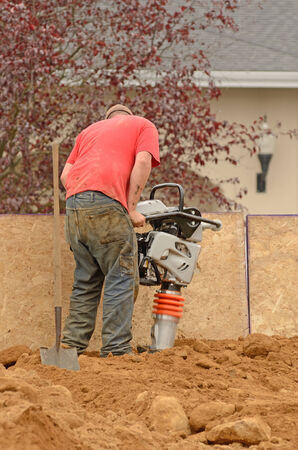 Commercial development building contractor working on building site installing a retaining wall Stock Photo
