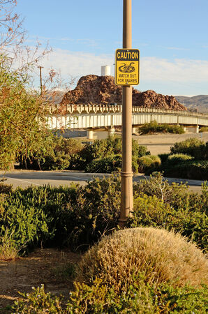 barstow: Watch out for Snakes sign in a city park in Barstow California