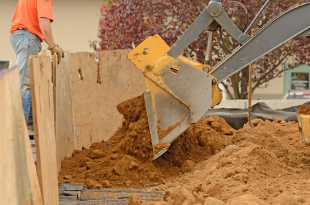 retaining: Commercial development building contractor working on building site installing a retaining wall Stock Photo