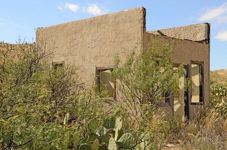 Old abandoned roaside small house near the small Texas town of Sierra Blanca photo