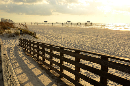 Pier and beach access to the Gulf of Mexico near Pensacola, during early morning light