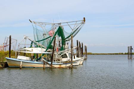 shrimp boat: Shimp and fishing boats at port in the swamp land near New Orleans Louisiana Stock Photo