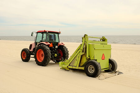 Beach groomer or rake on the cleaning the sand at Harrison County Sand Beach Louisianna
