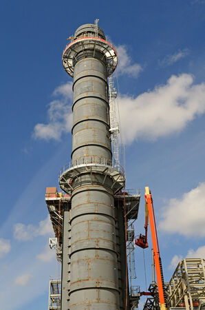 construction crew: A construction crew installing a new cooling tower on a chemical petroleum oil processing plant in New Orleans