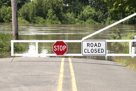Gate closing the road, due to high water, to a river ferry crossing over the Willamette River near Salem Oregon photo