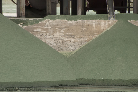 sand quarry: Piles of old nickle slag at a processing plant making sand blasting media.