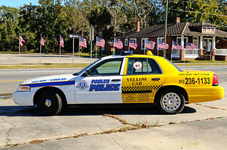 under arrest: A great visual concept of the price of driving impared using a police car and taxi combination in Pooler Georgia