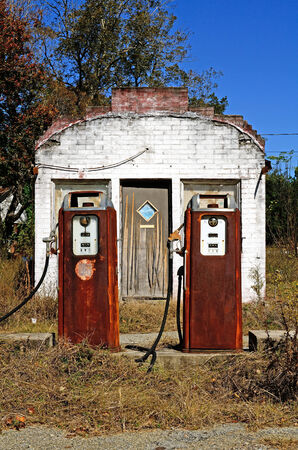 Old small roadside gas or fuel service station along an old hwy replaced by a freeway several miles away in southern United States photo