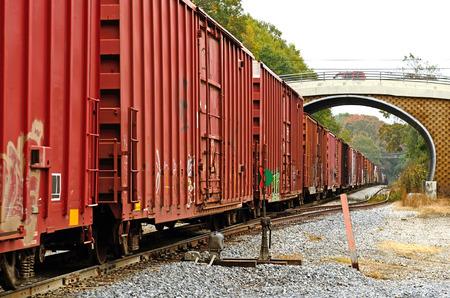 boxcar train: Rail road train coming through a small bridge in rural Louisiana