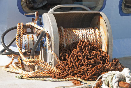 ship anchor: Galvanized Chain on a anchor winch on a fishing boat in Charleston Harbor on Oregon s Southcoast