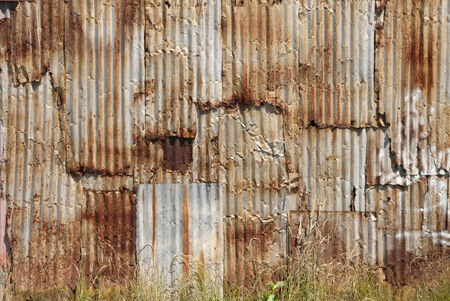 Old rusted corrigated metal wall on a building in the old town of Oakland Oregon Banco de Imagens