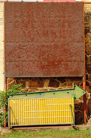 A old sign board with an arrow sits with no letters Stock fotó