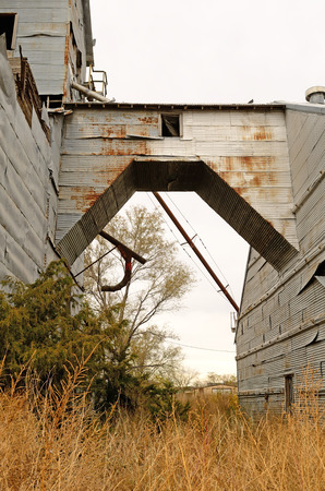 industrail: side of a old corugated metal industrail agricultural grain silo site in northeast Texas