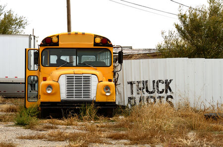 junked: Line of old junked school buses in a Amarillo Texas recycling yard