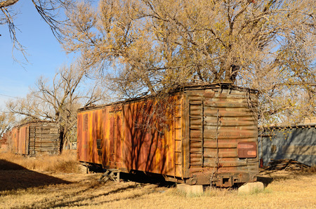 outbuilding: Old railroad box car being used as a storage outbuilding shed in northern Texas