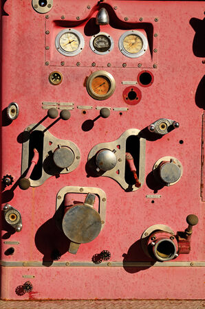 antique fire truck: Pump panel and controls off of an old abandoned  fire engine in Texas