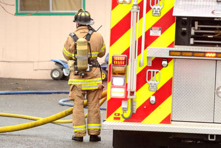 turnouts: Firefighters at the scene of a cooking fire in a kitchen of an apartment complex in Oregon Stock Photo