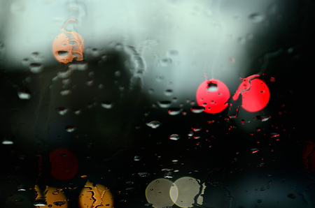 distort: Traffic lights through the windshield of a car Stock Photo