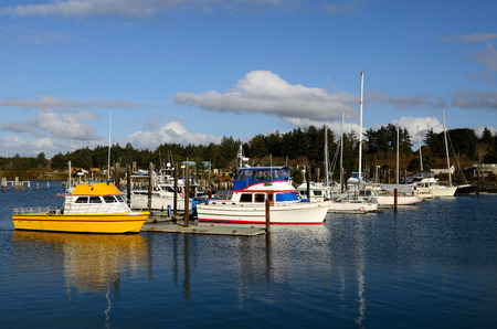coquille: Small fishing boats parked in the Coquille River marina, in Bandon Oregon Editorial