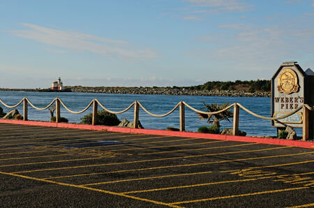 coquille: Boadwalk and public pier at  the mouth of the Coquille River, in Bandon Oregon Editorial