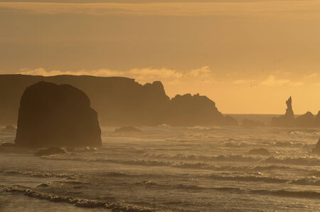 coquille: Face rock in the Pacfic Ocean near the mouth of the Coquille River, in Bandon Oregon