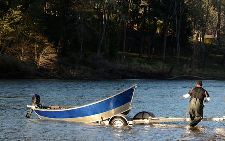 salmon run: Fishing drift boat on the Umpqua River during the spring chinook salmon run near Roseburg, Oregon, Feburary 14, 2013