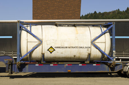 ammonium: A truck hauling ammonium nitrate in an emulsion form has a oxidizer 3375 placard in a tank on a intermodel trailer