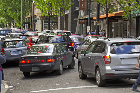 Several cars are backed up waiting for a light change in a Portland Oregon downtown area Editorial
